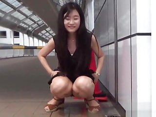 Fetish asian whore peeing in gutter