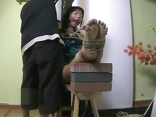Chinese slut gets tied on tiger bench
