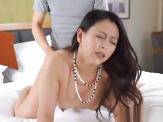 Arousing mature Japanese AV model enjoys younger dick