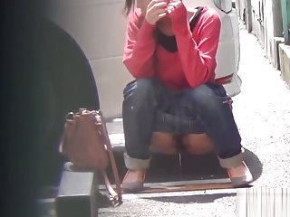 Asian whore pees behind car
